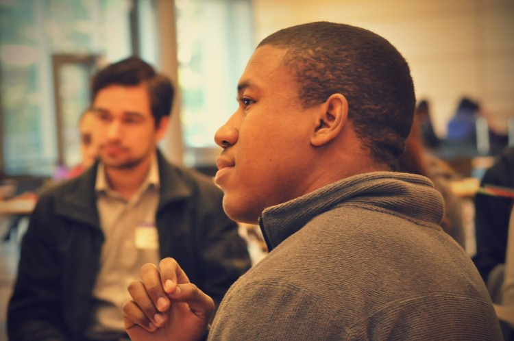 GO-MAP student listening intently to speaker out of the frame
